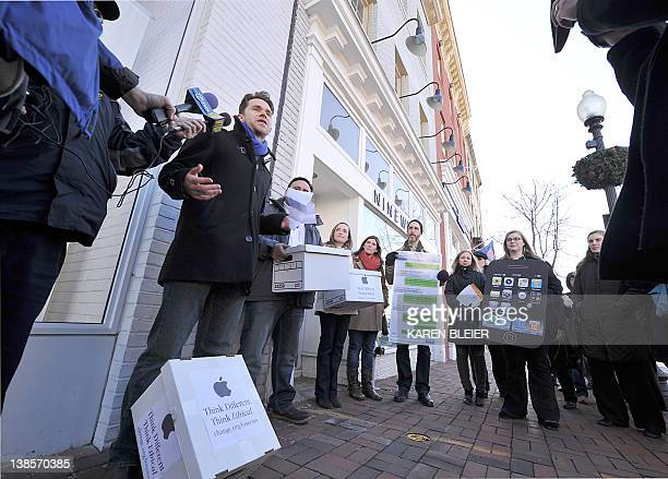 Mark Shields who launched the Campaign on Changeorg speaks to reporters during a protest in front of the Apple store in Washington DC on February 9...