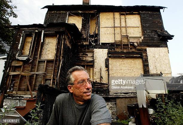 Mark Shorr sits outside his Queens NY home that burned when American Airlines Flight 587 crashed in his neighborhood Nov 12