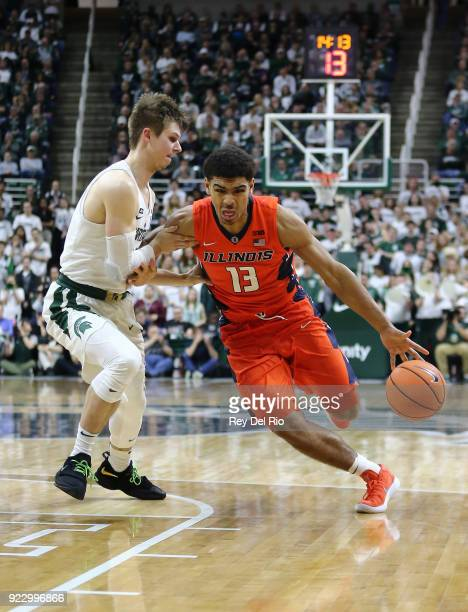 Mark Smith of the Illinois Fighting Illini drives to the basket while defended by Matt McQuaid of the Michigan State Spartans at Breslin Center on...