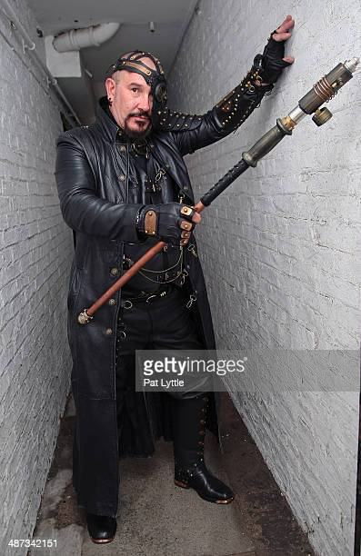 Mark Smith poses for a picture dressed in a black leather studded Steam Punk themed ensemble entirely made by himself during the WHitby Goth Weekend...