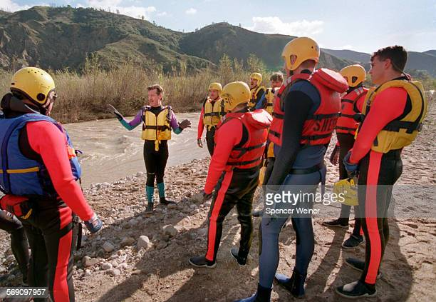 Mark Smitley a swift water rescue coordinator–trainer talks with Ventura County Sheriff's Deputies before a rescue exercise in the Santa Clara River...