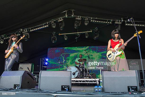 Mark Speer Donald ÒDJÓ Johnson and Laura Lee of Khruangbin perform at Umberslade Estate on June 5 2016 in TanworthinArden Warwickshire