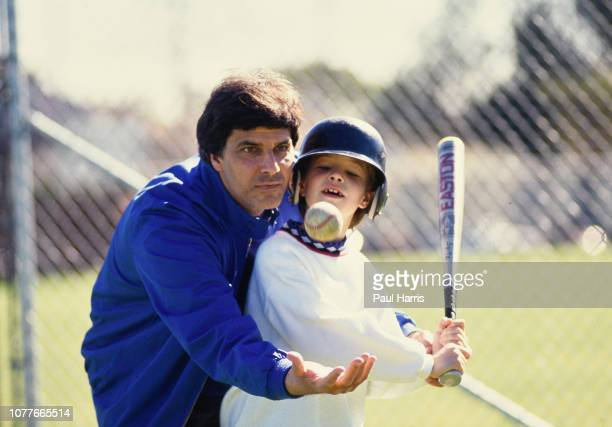 Mark Spitz teaches his son Matthew how to hit a baseball and attends a softball match Mark Spitz is trying to get in shape for the 1992 Olympics May...