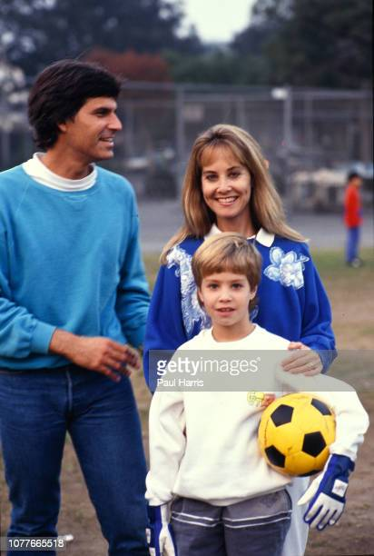 Mark Spitz with his wife Suzi and son Matthew attend a soccer match Mark Spitz is trying to get in shape for the 1992 Olympics May 17 1990 Pacific...