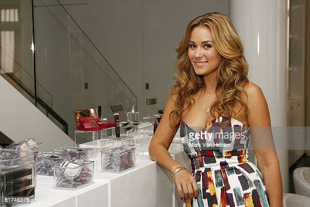 NEW YORK JUNE 16 Mark spokesperson Lauren Conrad stands next to a display of her favorite mark beauty products at the launch for the brand's new...