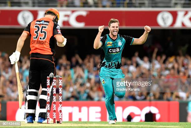 Mark Steketee of the Heat celebrates taking the wicket of Hilton Cartwright of the Scorchers during the Big Bash League match between the Brisbane...