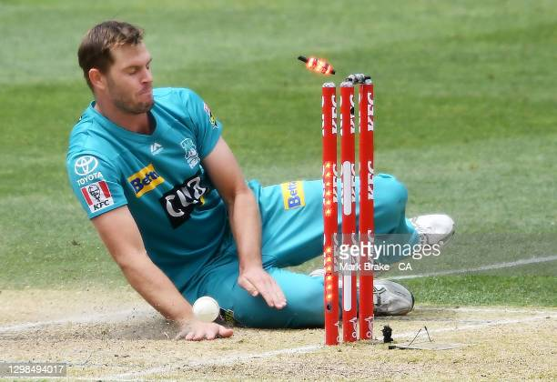 Mark Steketee of the Heat runs out Aaron Hardie of the Scorchers during the Big Bash League match between the Brisbane Heat and Perth Scorchers at...