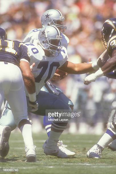 Mark Stepnoski of the Dallas Cowboys in position during a preseason football game against the San Diego Chargers on August 14 1989 at Jack Murphy...