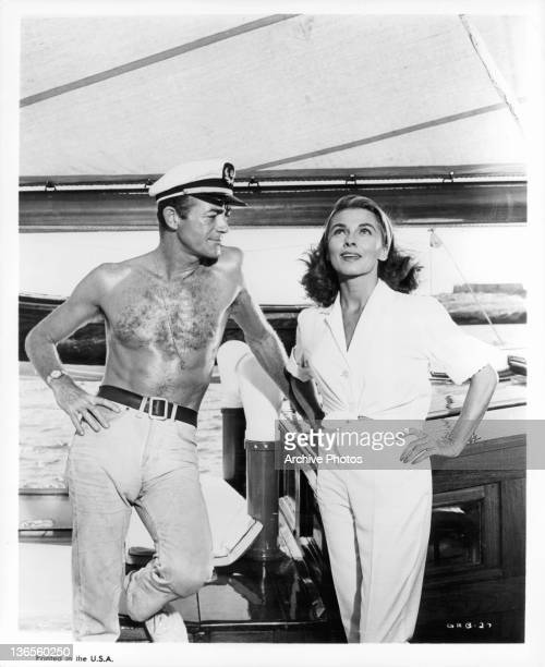 Mark Stevens and Joanne Dru on a yacht together in a scene from the film 'September Storm' 1960