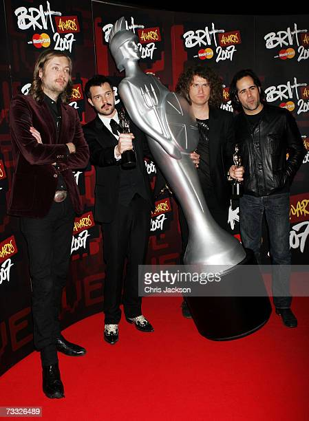 Mark Stoermer Brandon Flowers David Keuning and Ronnie Vannucci of Killers pose in the awards room after winning the awards for best International...