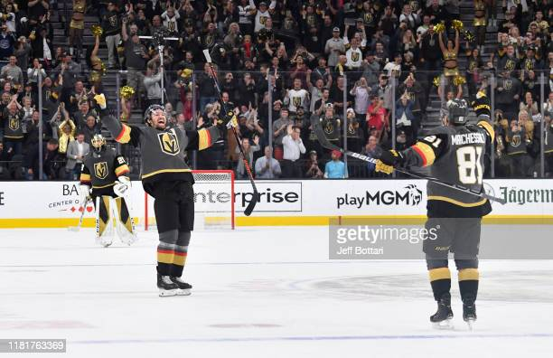 Mark Stone and Jonathan Marchessault of the Vegas Golden Knights celebrate after defeating the Ottawa Senators in a shootout at TMobile Arena on...
