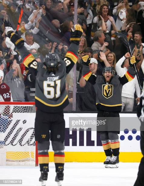 Mark Stone and Max Pacioretty of the Vegas Golden Knights celebrate Pacioretty's third-period empty-net goal against the Colorado Avalanche in Game...