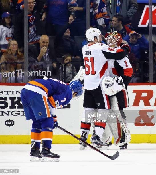 Mark Stone and Mike Condon of the Ottawa Senators celebrate their 65 victory over the New York Islanders at the Barclays Center on December 1 2017 in...