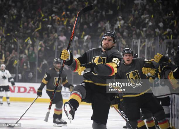 Mark Stone and Nate Schmidt of the Vegas Golden Knights celebrate with teammates on the bench after Schmidt assisted on Stone's firstperiod goal...