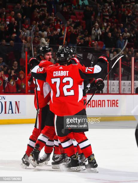Mark Stone and Thomas Chabot of the Ottawa Senators celebrate after a first period goal scored by teammate Zack Smith against the Chicago Blackhawks...