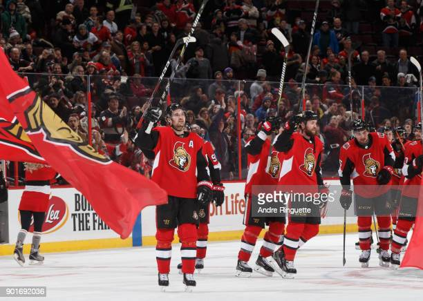 Mark Stone and Zack Smith of the Ottawa Senators raise their sticks to salute the fans after their overtime win against the San Jose Sharks at...