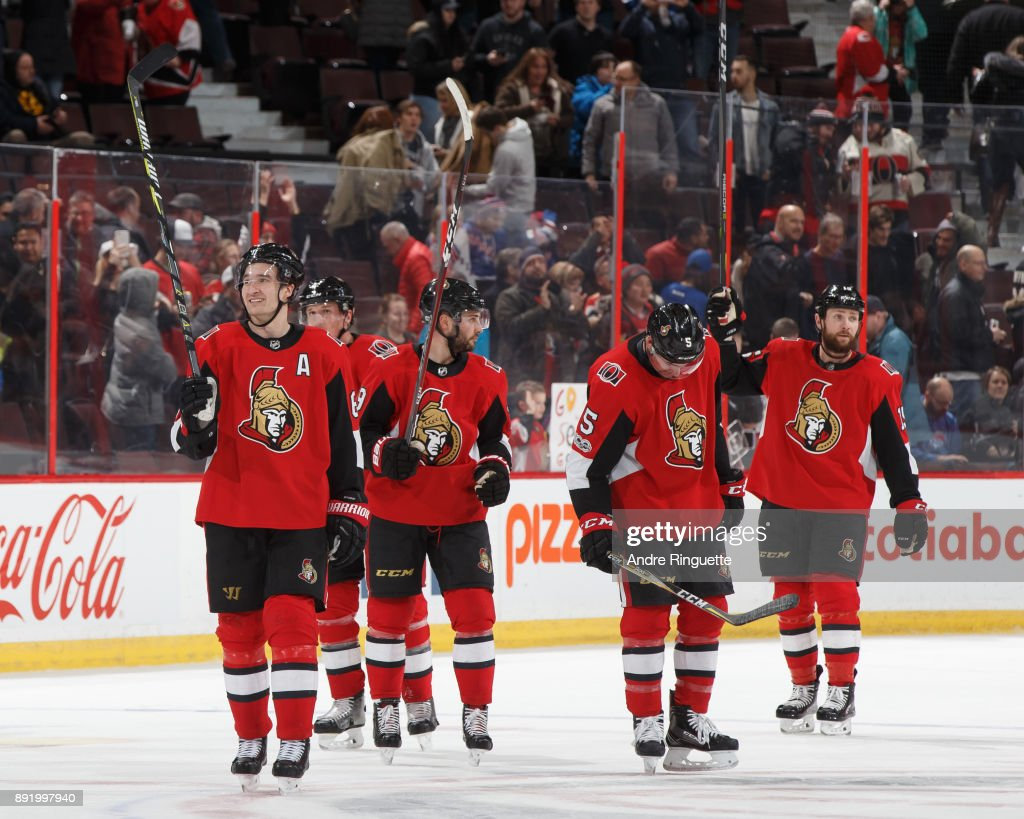 Mark Stone #61, Dion Phaneuf #2, Derick Brassard #19, Cody Ceci #5 and Zack Smith #15 of the Ottawa Senators celebrate a 3-2 victory against the New York Rangers at Canadian Tire Centre on December 13, 2017 in Ottawa, Ontario, Canada.