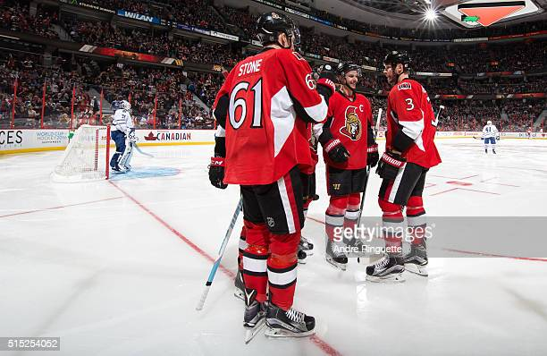 Mark Stone Erik Karlsson and Marc Methot of the Ottawa Senators celebrate a third period goal against the Toronto Maple Leafs at Canadian Tire Centre...