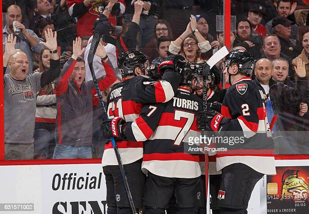 Mark Stone Kyle Turris Erik Karlsson and Dion Phaneuf of the Ottawa Senators celebrate a first period power play goal by teammate Mike Hoffman...