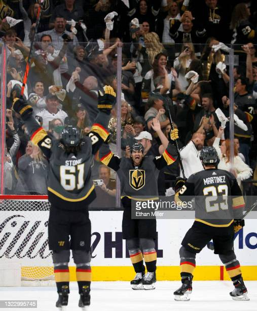 Mark Stone, Max Pacioretty and Alec Martinez of the Vegas Golden Knights celebrate Pacioretty's third-period empty-net goal against the Colorado...