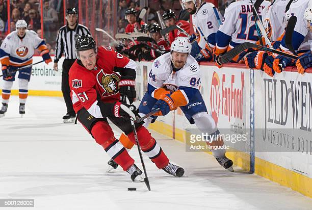 Mark Stone of the Ottawa Senators battles for puck possession against Mikhail Grabovski of the New York Islanders at Canadian Tire Centre on December...