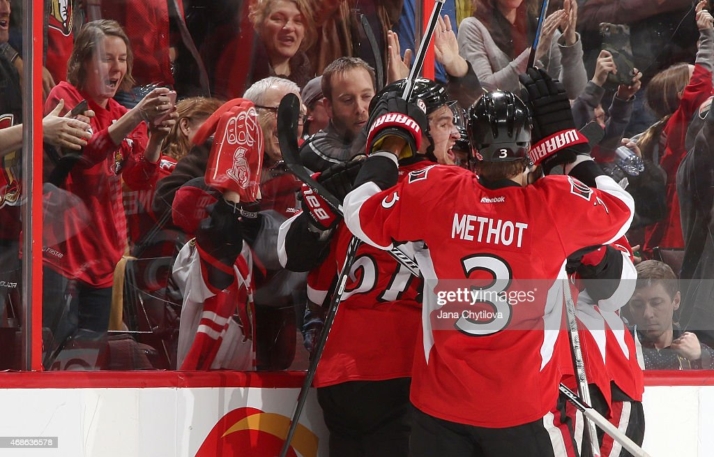 Mark Stone #61 of the Ottawa Senators celebrates an overtime goal against the Washington Capitals with teammate Marc Methot #3 at Canadian Tire Centre on April 4, 2015 in Ottawa, Ontario, Canada.