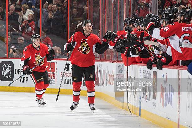 Mark Stone of the Ottawa Senators celebrates his first goal of the game against the Tampa Bay Lightning with JeanGabriel Pageau and other teammates...