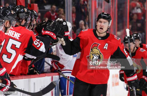 Mark Stone of the Ottawa Senators celebrates his first period goal against the Montreal Canadiens with team mates on the bench at Canadian Tire...