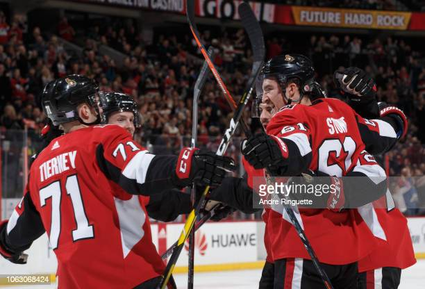 Mark Stone of the Ottawa Senators celebrates his first period goal against the Pittsburgh Penguins with teammates including Chris Tierney at Canadian...