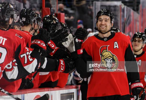 Mark Stone of the Ottawa Senators celebrates his first period goal against the Winnipeg Jets with team mates on the bench at Canadian Tire Centre on...