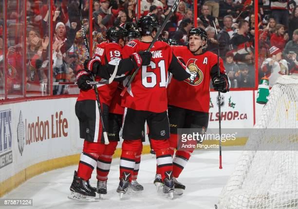 Mark Stone of the Ottawa Senators celebrates his first period goal against the Arizona Coyotes with teammates Derick Brassard and Dion Phaneuf at...