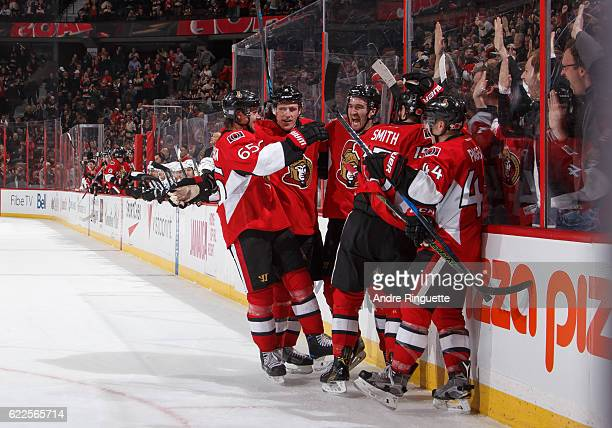 Mark Stone of the Ottawa Senators celebrates his last minute gamewinning third period goal against the Los Angeles Kings with teammates Erik Karlsson...
