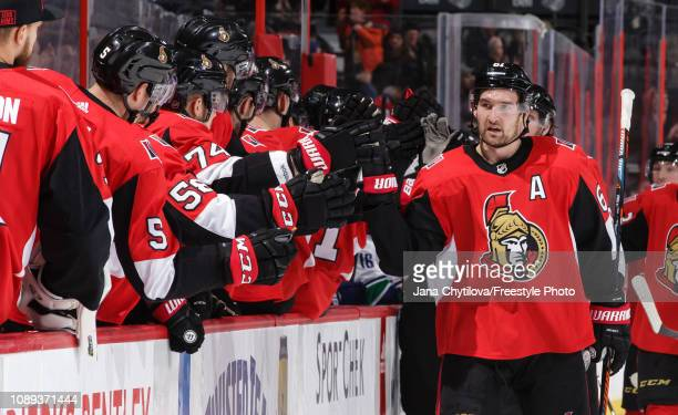 Mark Stone of the Ottawa Senators celebrates his late third period goal against the Vancouver Canucks with teammates on the bench at Canadian Tire...