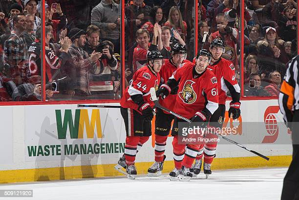 Mark Stone of the Ottawa Senators celebrates his second goal of the game against the Tampa Bay Lightning with teammates JeanGabriel Pageau Cody Ceci...