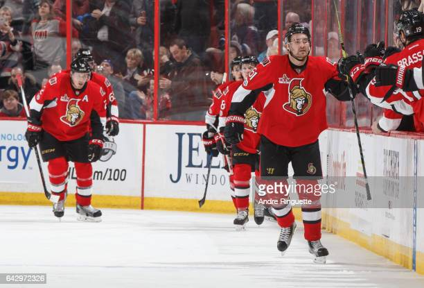Mark Stone of the Ottawa Senators celebrates his second period goal against the Winnipeg Jets with teammates at the players bench at Canadian Tire...
