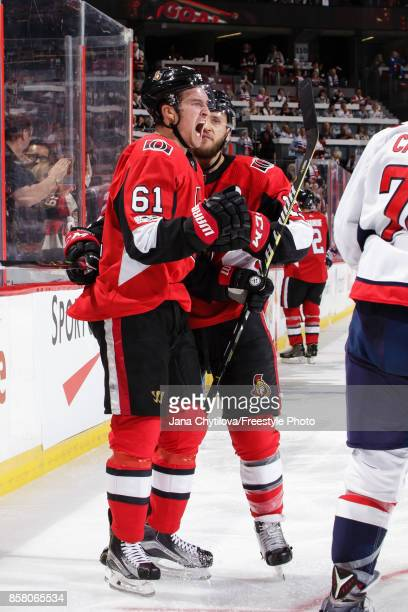 Mark Stone of the Ottawa Senators celebrates his second period goal against the Washington Capitals with teammate Fredrik Claesson at Canadian Tire...