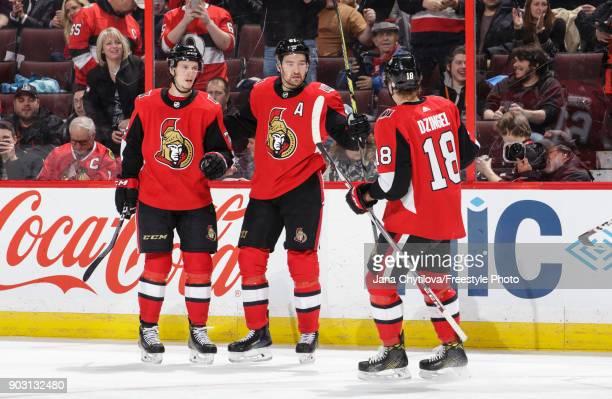 Mark Stone of the Ottawa Senators celebrates his second period goal against the Chicago Blackhawks with teammates Thomas Chabot and Ryan Dzingel at...