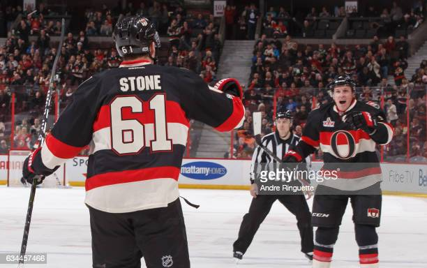 Mark Stone of the Ottawa Senators celebrates his third period goal against the Dallas Stars with teammate Dion Phaneuf at Canadian Tire Centre on...