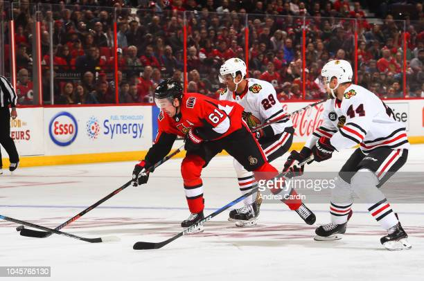 Mark Stone of the Ottawa Senators chases down a loose puck with Jan Rutta of the Chicago Blackhawks chasing at Canadian Tire Centre on October 4 2018...