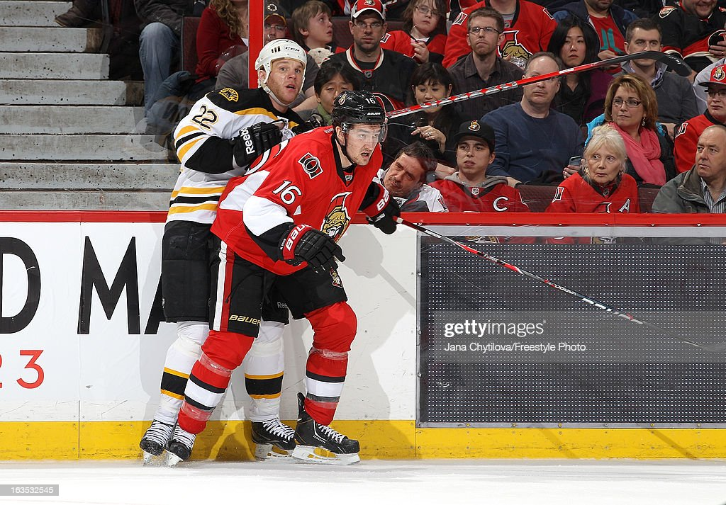 Mark Stone #16 of the Ottawa Senators checks Shawn Thornton #22 of the Boston Bruins along the boards, during an NHL game at Scotiabank Place, on March 11, 2013 in Ottawa, Ontario, Canada.