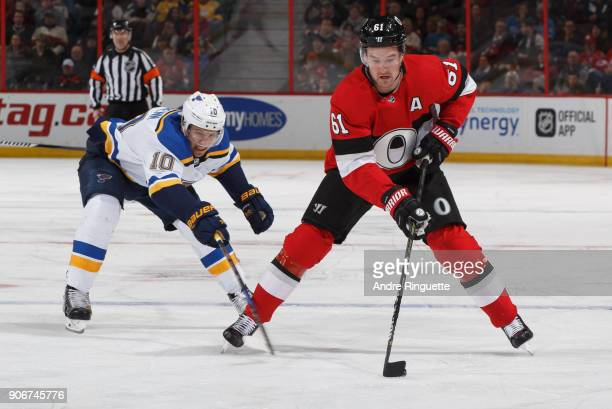 Mark Stone of the Ottawa Senators controls the puck against Brayden Schenn of the St Louis Blues at Canadian Tire Centre on January 18 2018 in Ottawa...
