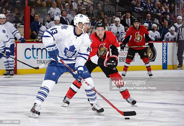 Mark Stone of the Ottawa Senators forechecks Nazem Kadri of the Toronto Maple Leafs as he looks to make a pass during an NHL game at Canadian Tire...