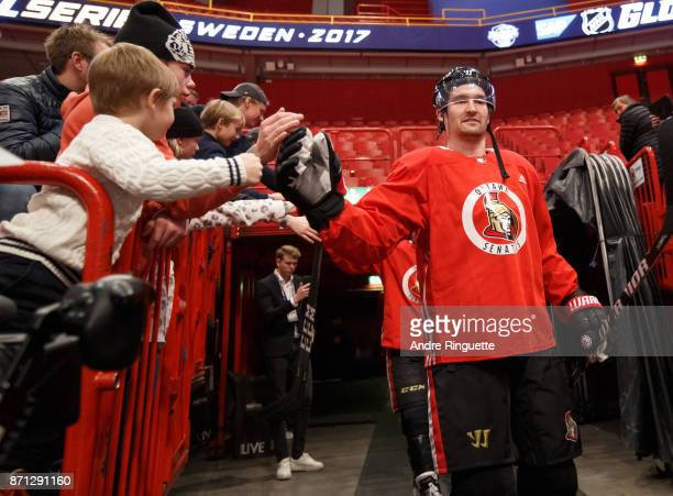 Mark Stone of the Ottawa Senators highfives a fan as he walks down to the ice for practice at Ericsson Globe on November 7 2017 in Stockholm Sweden