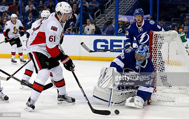 Mark Stone of the Ottawa Senators is stopped by Ben Bishop of the Tampa Bay Lightning at the Amalie Arena on December 10 2015 in Tampa Florida