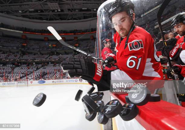 Mark Stone of the Ottawa Senators knocks a stack of pucks to the ice to start warmup prior to playing against the New York Rangers in Game One of the...