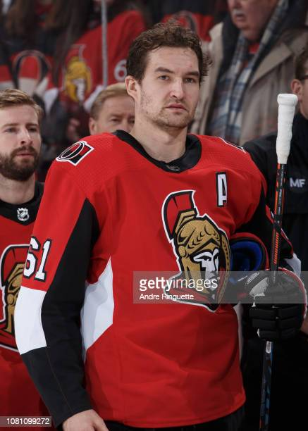 Mark Stone of the Ottawa Senators looks on from the bench during the singing of the national anthems prior to a game against the Boston Bruins at...