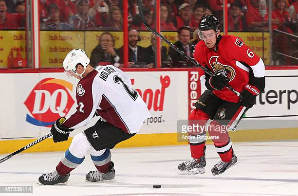 Mark Stone of the Ottawa Senators makes a move with the puck at the blue line against Nick Holden of the Colorado Avalanche at Canadian Tire Centre...