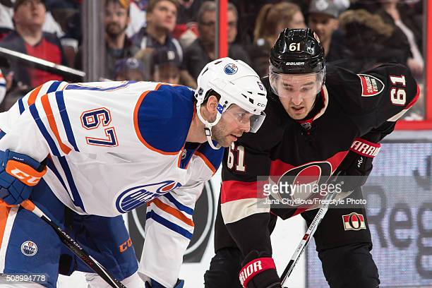 Mark Stone of the Ottawa Senators prepares for a faceoff against Benoit Pouliot of the Edmonton Oilers during an NHL game at Canadian Tire Centre on...
