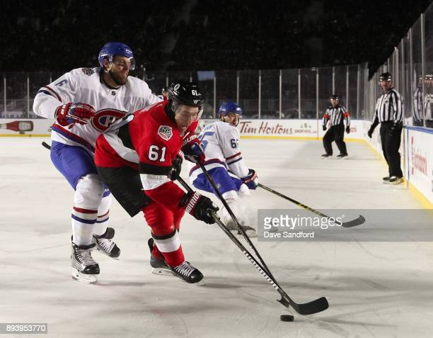 Mark Stone of the Ottawa Senators pulls the puck away from Shea Weber of the Montreal Canadiens during the 2017 Scotiabank NHL100 Classic at...