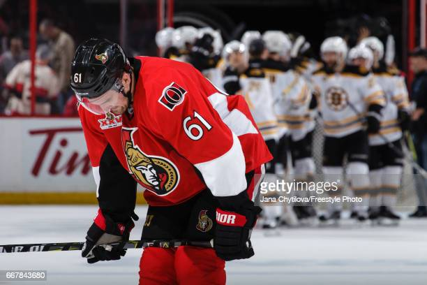 Mark Stone of the Ottawa Senators reacts as the Boston Bruins celebrate a win in Game One of the Eastern Conference First Round during the 2017 NHL...